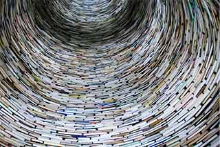 image of the interior of a largecircular tower of books